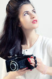 Portrait of a girl photographer. Studio photo of a girl with a camera Royalty Free Stock Photography
