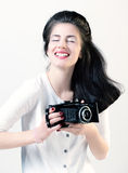 Portrait of a girl photographer. Studio photo of a girl with a camera Royalty Free Stock Photos