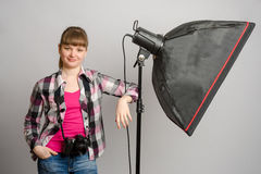 Portrait of girl photographer at the studio softbox. Portrait of a girl the photographer at the studio softbox stock images