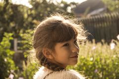 Portrait of a girl with a pigtail on a sunny day royalty free stock photo