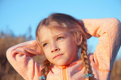 Portrait of a girl with pigtails closeup outdoors Royalty Free Stock Photography