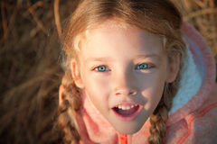 Portrait of a girl with pigtails closeup outdoors Royalty Free Stock Photos