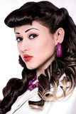 Portrait of girl with pin-up make-up and hairdo royalty free stock image