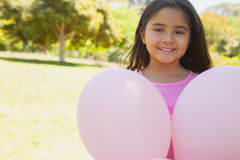 Portrait of a girl with pink balloons at park Royalty Free Stock Photo