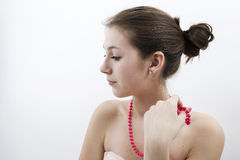 Portrait of a girl with pink beads Stock Photos