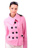Portrait of girl in pink coat Stock Photography