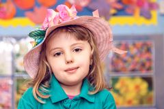 Portrait of a girl with a pink hat royalty free stock photo
