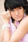 Portrait of a girl in a pink pareo Stock Photography