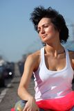 Portrait of girl in pink skirt on highway Stock Photography