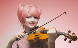 Portrait of girl in pink wig Royalty Free Stock Photography
