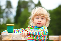 Portrait of the girl on a playground with a toy Royalty Free Stock Photography