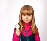 Portrait of girl playing doctor Stock Image