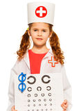 Portrait of girl playing doctor ophthalmologist Royalty Free Stock Image