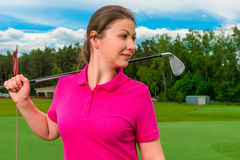 Portrait of a  girl playing golf. Portrait of a young girl playing golf Stock Photo