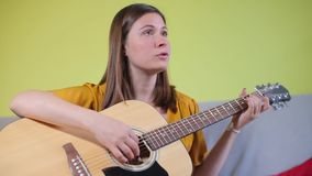Portrait, girl playing guitar, talking stock video footage