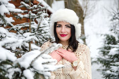 Portrait of girl posing under snow-covered trees Royalty Free Stock Photos