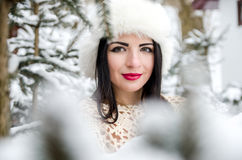 Portrait of girl posing under snow-covered trees Royalty Free Stock Photography