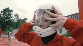 Portrait girl in protective helmet slow motion. Young woman in protective helmet stock footage