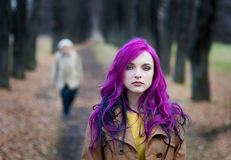 Portrait of a girl with purple hair. Freak girl with purple hair in autumn park Royalty Free Stock Photography