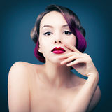 Portrait of a girl with purple hair. Studio photo of a young woman with purple hair and lips Royalty Free Stock Photo