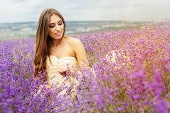 Portrait of girl  at purple lavender field Royalty Free Stock Photos