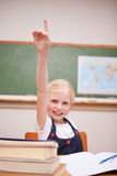Portrait of a girl raising her hand Stock Photo