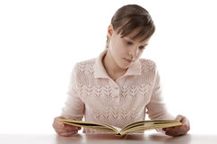 Portrait of a girl reading. With enthusiasm Stock Images