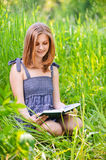 Portrait of girl reading book Royalty Free Stock Images