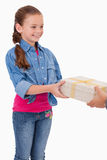 Portrait of a girl receiving a gift. Against a white background Stock Image