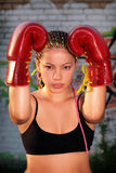 Portrait of a girl with red boxing gloves Royalty Free Stock Photography