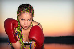 Portrait of a girl with red boxing gloves Stock Image