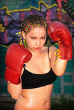 Portrait of a girl with red boxing gloves Royalty Free Stock Photos