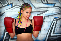 Portrait of a girl with red boxing gloves Royalty Free Stock Photo