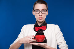 Portrait of a girl with red cup in his hands Stock Images