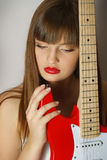 Portrait of girl with the red guitar Stock Photo