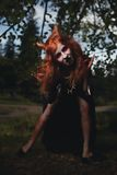 Portrait girl with red hair and bloody face vampire, murderer, psycho, halloween theme, bloody woman Stock Photos