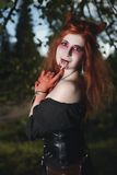Portrait girl with red hair and bloody face vampire, murderer, psycho, halloween theme, bloody woman Stock Images