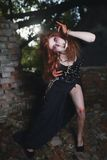 Portrait girl with red hair and bloody face vampire, murderer, psycho, halloween theme, bloody woman Royalty Free Stock Image