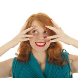 Portrait girl with red hair funny hiding Stock Photo