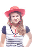 Portrait of a girl in a red hat. Studio photography Stock Photography