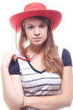 Portrait of a girl in a red hat. Studio photography Royalty Free Stock Photos