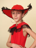 Portrait of a girl in red hat and black lace Royalty Free Stock Images
