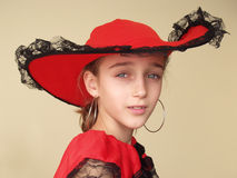 Portrait of a girl in red hat and dress with black lace royalty free stock photo