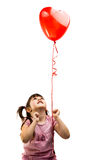 portrait of a girl with red heart balloon Stock Images