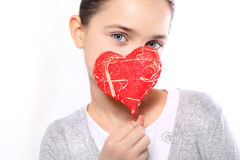Portrait of a girl with red heart symbol Royalty Free Stock Photos