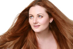 Portrait of a girl with red, long hair Royalty Free Stock Photos