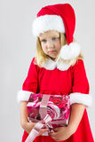 Portrait of a girl in a red new year cap Royalty Free Stock Images