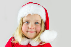 Portrait of a girl in a red new year cap Stock Images