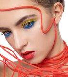 Portrait of a girl with a red rope on her face stock photos