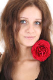 Portrait of girl with red rose in hair Stock Image